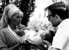 Britt Ekland, Peter Sellers and little Victoria. November, 1965.