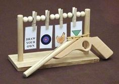 FREE RUBBER BAND GUN woodworking plans and information at WoodworkersWorkshop® Toy, Rubberband Gun - with targets, free plans projects patterns woodworking. Woodworking For Kids, Woodworking Toys, Popular Woodworking, Woodworking Furniture, Furniture Plans, Kids Furniture, Woodworking Articles, Woodworking Software, Woodworking Beginner