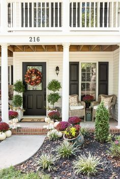 Create a cozy fall porch using plum and red mums with gold lanterns and floral toss pillows. Fall Porch Inspiration #fallporch #falldecor Enclosed Porches, Screened In Porch, Porch Swing, Home Decor Bedroom, Entryway Decor, Entryway Ideas, Porch Kits, Porch Ideas, Gold Lanterns