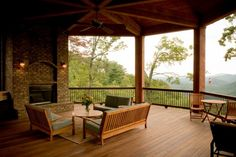 Outdoor exposed brick #fireplace on a deck with an amazing view. I'll take it!