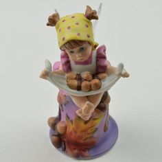 This porcelain bell features the Autumn Fairie, she is perched on top of the bell and doubles as it's handle.