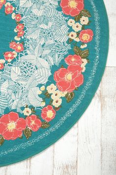 maybe a round rug would look neat! I love the different shades of turquoise in this one!