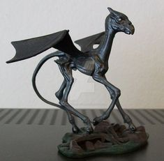 This is a Harry Potter Thestral kit foal - the last kit i had. He is a commission piece so not for sale. He is about 1/16th scale and is done in metallic blue, black and silver with glow in the dar...