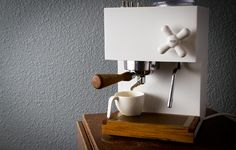 White modern Corian® coffee maker by Montaag. Love this wood complement for the kitchen!