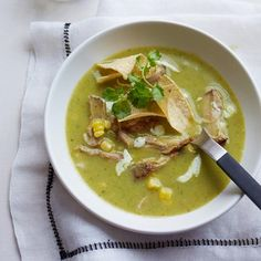 Tortilla-Corn Soup | Corn tortillas help make this soup thick and hearty, and they also act as a crunchy garnish.
