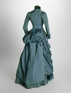 Blue silk and velvet dress (back view), 1884-85. Worn at a wedding in 1885.