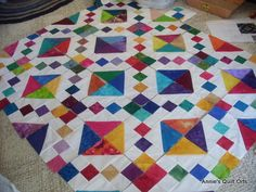 Jewel Box quilt pattern in primary colors See abracadabraquilting.com for pattern