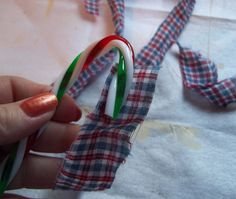 You might want to buy some plastic candy canes when you see this gorgeous ornament idea!