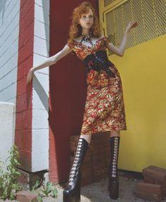 Model Maddison Stubbington poses in Prada brocade dress with wool corset