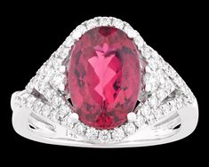 Rubellite and Diamond Ring, 3.17 Carats~ A rare rubellite tourmaline with a richly saturated crimson hue is at the center of this eye-catching ring. Weighing 3.17 carats, the oval gemstone is encircled by a halo of diamonds totaling 0.59 carat. Set in 14K white gold. ~M.S. Rau Gemstones For Sale, Rare Gemstones, Tourmaline Ring, Alexandrite, Gemstone Colors, Peridot, Garnet, Halo, Cuff Bracelets
