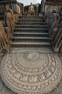 Ancient temple ruins in Anuradhapura in Sri Lanka. The intricately carved bottom stone is called the 'Moonstone' and the steps lead to a still intact, sitting Buddha