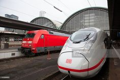 A Siemens AG 407 series InterCity Express (ICE) 3 Velaro-D train, operated by Deutsche Bahn (DB) AG, right, sits alongside a DB Regio train at the central railway station in Frankfurt, Germany, on Tuesday, Feb. 18, 2014. Siemens AG said the first four of 16 trains ordered by Deutsche Bahn AG received regulatory approval to operate, two years after delays on the new model started burdening earnings at Europe's largest engineering company.