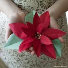 Tutorial: DIY Paper Poinsettia with free printable template... decorate your tree, make into a wreath, tie onto a garland, or use as a gift topper   {Lia Griffith}