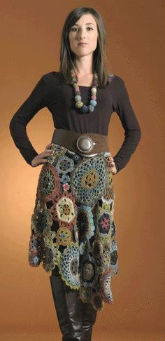 subdued grouping of doilies connected into a skirt.  1804_628409157193653_1389766318_n.jpg (300×619)
