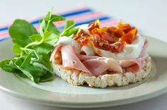 ❝Try Rice Cake Topped With Chunky Sliced Ham, Sun-Blush Tomatoes, Buffalo Mozzarella Cheese, All On A Bed Of Fiery Watercress.❞  (pic + recipe = Kallo Food Academy)