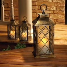 """Cordless LED Lantern. Brushed brass-like metal housing has clear glass panes, and sturdy plastic hanger on top. Features an on/off timer switch on bottom; uses 2 C batteries, not included. 14 1/4"""" H, 5 1/2"""" square. $20.99"""