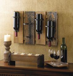 This unique and rustic wall-mounted wine rack will attract a lot of attention, and not just because it holds your favorite wine! Four wooden slats mount to your wall and feature simple metal wine hold More