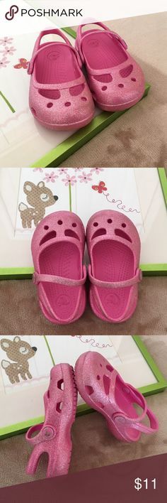glitter Mary Jane flats sz 6 Pink Glitter flats size 6. See pics for minor wear on shoes. In excellent condition, no known holes or defects. Shows normal wear & wash. From smoke & pet free home. (E) CROCS Shoes