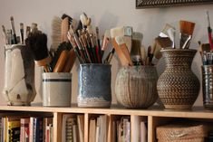 Paint brushes in ceramic jars
