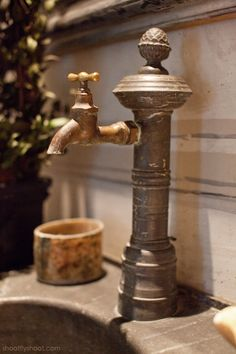 i wonder if i could incorporate my old & cherished outdoor hummingbird tap to work indoors....  (Atchison Home | Antique Faucet)