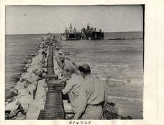 WWII Human Convoy of British 8th Army Unloads Transport in Tunisia Press Photo