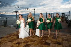 Emerald green bridesmaid dresses | @West Shore Cafe wedding by Scott Corridan Design and Ciprian Photography