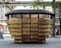 Vendors just unfasten a padlock to gain access to their kiosk. The kiosk was temporarily at the V&A last summer. Kiosk Design, Retail Design, Thomas Heatherwick, Wood Facade, Kensington And Chelsea, Chelsea London, Small Buildings, Amazing Buildings, Pop Up Shops