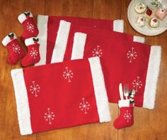 "Santa Christmas Placemat & Silverware Holder Set By Collections Etc by Collections. $8.97. Santa set the table with this jolly 8-pc. linen set. Includes 4 red felt placemats trimmed with fleece and snowflake embroidery. Lined utensil holders look like Christmas stockings with holly appliqus. Polyester; imported. Machine wash. Placemats 19"" x 14""; stockings 6""H."
