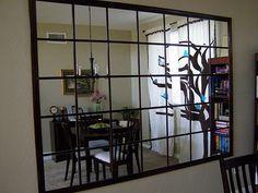DIY Mirrored Wall using IKEA Lots mirrors.