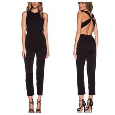 Alice + Olivia jumpsuit Like new condition. 2015 Alice Olivia jumpsuit. Gorgeous cross back jumpsuit in black. Size 2! Alice + Olivia Other