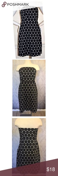 The Limited Spring-Summer Dress The Limited Strapless Polka Dot Spring-Summer Dress.  Lined with a zipper and hook on the side.  Thin rubber gripping around the top so it won't slip. Size 6. Shell 98% cotton, 2% spandex. Lining 100% polyester. The Limited Dresses Strapless