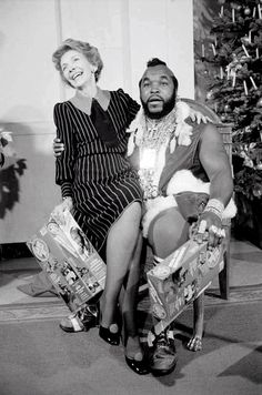 Strange combination but the picture says it all, they are having a good laugh - previous First Lady and Mr T