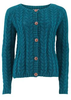 Hand knitted teal cardigan in 100% wool. Vintage-inspired cable knit pattern cardigan with wooden buttons. Length 54cm.
