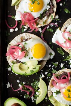 Healthy Huevos Rancheros Breakfast Tostadas topped with creamy avocado and pickled onions. These breakfast tostadas are a delicious breakfast option that are high in protein and fiber with only 292 calories a serving! Huevos Rancheros, Paleo Sweet Potato, Sweet Potato Hash, Tostadas, Empanadas, Chorizo, Enchiladas, Baked Egg Cups, Healthy Breakfast Recipes