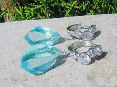 Sparkling cubic zirconia hoops with sky blue quartz.