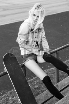 Beautiful girl having fun. Pretty girl sitting in row of  wood  seats at school stadium. Rest from study. Outdoors, Lifestyle photo
