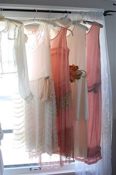 dresses from the 1920s. I'm in love with the middle one... the pink + lace.