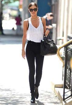 Miranda Kerr looking hot in black skinnies and a loose-fit tank