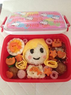 Japonica rice covered with layer of scrambled egg, with meat balls carrots, sausages, sliced ham, boiled egg and broccoli. [Created and prepared by Lhen Subong Kaitsuka]