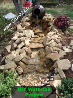 DIY Easy Waterfall Project design!  I did this project on the cheap!  I used old trash rugs underneath the pond liner and rocks around my place!!   |  iSaveA2Z.com