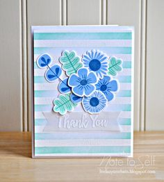 A slightly different way to do the stripes: instead of stamping a color with the background stamp, she used Versamark and white heat-embossed the stripes and then sponged on the blue/green stripes.