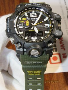 On sales from Japan at best price for this G-Shock Mudmaster Triple Sensor (with black with olive band) mud resist that designed for Deserts, Mud, and Tough Environments Amazing Watches, Beautiful Watches, Cool Watches, Wrist Watches, G Shock Watches Mens, Casio G Shock, G Shock Mudman, G Shock Mudmaster, Bottle Cap Table