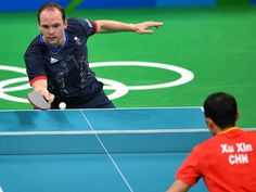 Best images from Aug. 14 at the Rio Olympics:      Paul Drinkhall of Great Britan competes against Xin Xu of China in a table tennis match at Riocentro - Pavilion 3 during the Rio 2016 Summer Olympic Games.
