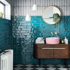 Who says a bathroom can\'t be beautiful? Look at these stunning teal tiles, paired with brass taps, a pink sink and a beautiful mid-century modern sideboard. Image by @sophierobinsoninteriors #mirador #miradorlife #decor #homedecor #style #inspiration #indoorplants #plants #colour #midcenturymodent #eclectic