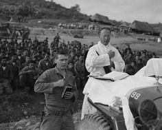 Another image of Mass celebrated on the hood of a Jeep in the battlefield.