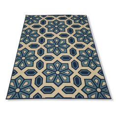 Cayman Outdoor Mosaic Rug:  With our Cayman Outdoor Mosaic Rug you can achieve the perfect balance of high style and high durability. This quick-drying, soft loop rug is perfect outdoors or in a high-traffic area inside your home. The bold and sophisticated design incorporates indigo and Mediterranean blues on a natural ground.