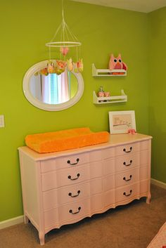 love the mirror & shelves (spice racks from Ikea?) above dresser/changing pad; also love the idea of another mobile above changing pad!