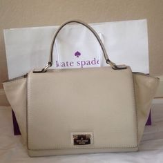 """Kate Spade Suede Large Laurel Kate Spade wkru2735.  This is a beautiful and versatile purse.  It can be worn as a crossbody or handbag.  Item is in excellent used condition with minimal signs of wear.  Minor scratches on Kate spade name decal other than that very clean inside and out.  Dust bag included. Color is """" ostrich egg"""". Genuine Leather, 14k light gold plated hardware, Interior features zip, cellphone and multi-function pockets. Top handle with 4-1/2"""" drop Clasp flap closure; flat…"""