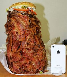 This is how a burger from Burger King with 1050-slices of bacon compares with an iPhone 4S.