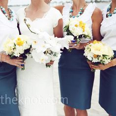 LOVE the bridesmaids in pencil skirts with the white sleeveless tops and ADORABLE necklaces!